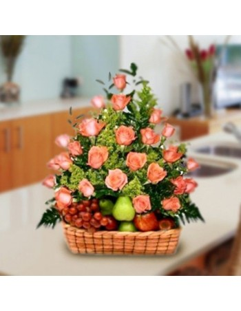 Fruit bowl with pink rose