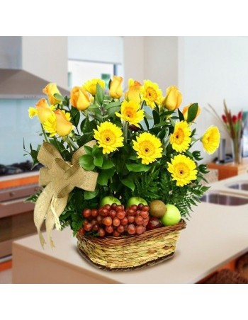Basket of roses, gerberas and fruits