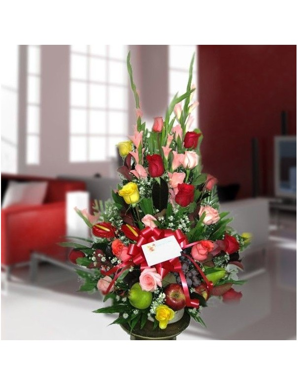 Arrangement with roses and assorted fruits